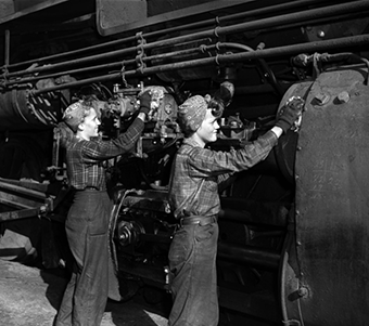 Women working on airplane in WWII