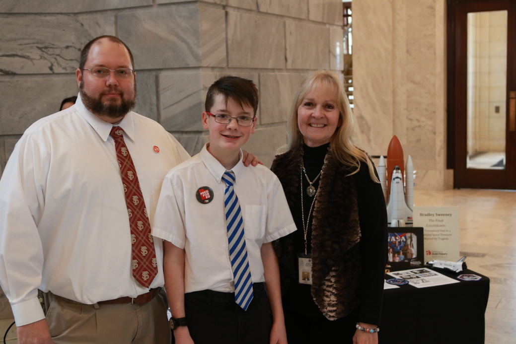 Bradley Sweeney (center) visits with Rep. Christine Watkins