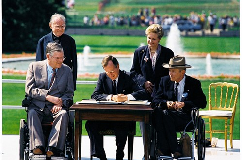 President George H.W. Bush signs the Americans with Disabilities Act into Law 1990 Courtesy Wikimedia